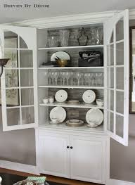 It's our dining room and the last item that I crossed off of my to-do list  was lining the back of our built-in china cabinet: