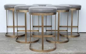 milo baughman burnished brass bar stools in grey leather at stdibs