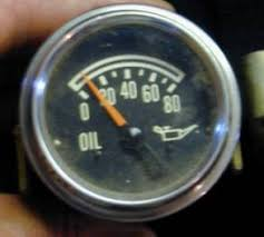the new gauge page the oil pressure gauge has a solid core meter movement there are a couple of wires wrapped around an iron core the needle itself is mounted on a little