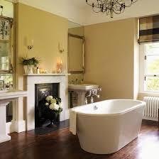 ensuite bathroom ideas uk. en-suite bathroom with yellow walls, freestanding bath, fireplace and floorboards ensuite ideas uk w