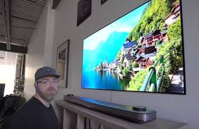 lg wallpaper tv. \u201cthe lg wallpaper tv is the thinnest display i\u0027ve ever seen or held. it\u0027s thinner than a smartphone and i can easily pick up 65-inch! lg tv