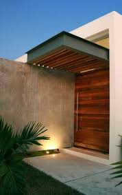 Lovely plants and manicured bushes soften the sleek, clean line architecture of the house. Modern House Entrance Design Ideas Storiestrending Com