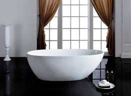 modern freestanding soaking bathtub chrome pop up center drain included faucet is not included sold separately easy to clean non porous surface