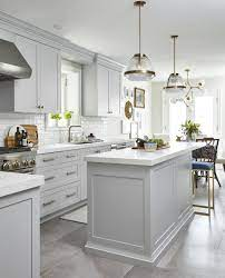 Light Grey Kitchen With Celestial Chandelier Over The Kitchen Table White Quartz Countertops O Kitchen Cabinet Design White Kitchen Design Kitchen Concepts