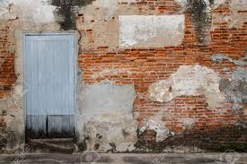 old door and old brick wall as background stock photo 17122282