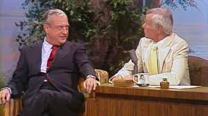 Image result for picture of rodney dangerfield sitting at desk with johnny carson