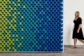 scale turns the acoustic panel on its ear