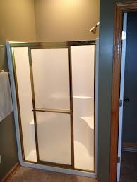 before small fiberglass shower with a skinny entry through a sliding glass door