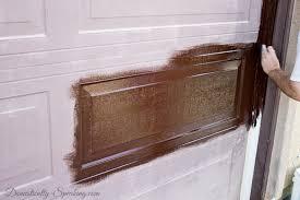 painting garage doorDIY Garage Door Makeover with Stain  Domestically Speaking