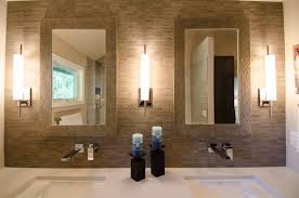 dark candle holders between square wash basin under cool cranes inside modern bathroom sconces with stick wall lamps on interesting wall pattern beside bathroom sconce lighting modern