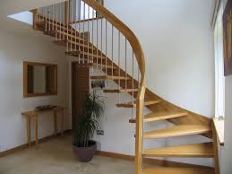 fancy curved modern staircase with wooden frames as space saving interior feat white wall painted color also wall mirror and entryway table in small house