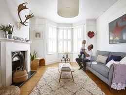 modren victorian style living room with fireplace and stag skull hung above