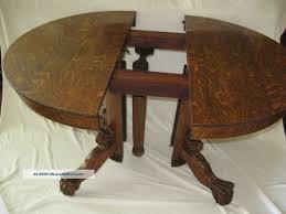 dining table tiger oak pedestal dining table