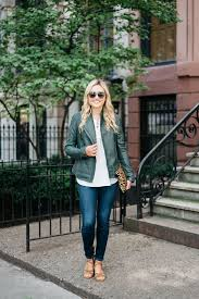 bows sequins wearing a green leather jacket with jeans and a leopard clutch for fall