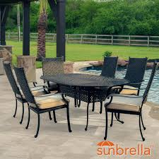 Carondelet 7 piece wicker patio dining set w 84 inch oval patio dining table sunbrella spectrum sand cushions by lakeview outdoor designs bbq guys