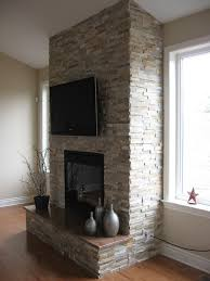 fireplace done with realstone systems sierra shadowstone with granite hearth