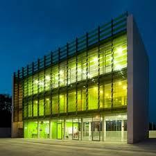 Two green coloured glass facades for this cultural building (Casal de  Berri) by Jordi