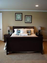 espresso wooden bed design ideas with legs tufted headboard come with white pillows with blue tufted