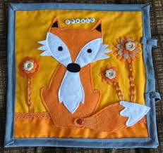 orange fox quiet book page i saw one where the legs and arms and tail could e off and attach with velcro