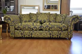 outrageous yellow gold damask pattern sofa with mive scroll arms