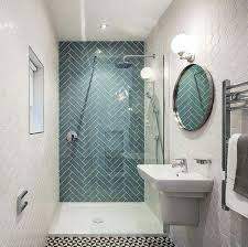 glass tiles for bathroom walls. ocean glass tile large installed in herringbone pattern shower. like that the shower has an accent wall. pattern. tiles for bathroom walls