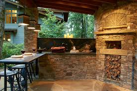 Outdoor Kitchen with Wood Burning Pizza Oven rustic-patio