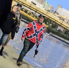 man in confederate flag shirt trump