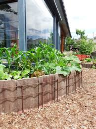 concrete roof tiles used with reo to make a curved raised garden bed soil from