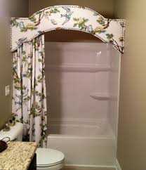 fabric covered cornice board in bathroom with matching shower curtain