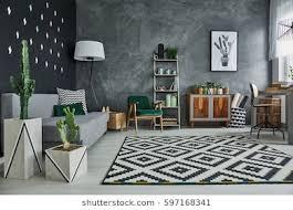 stylish furniture for living room. Living Room Interior With Plants And Stylish Furniture For