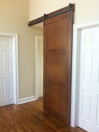3 panel birch barn door to cover a hall way sliding barn doors wood doors