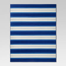 first up are great coastal inspired rugs this blue and white striped rug is an all weather rug which would work fabulously on a patio deck or sunroom