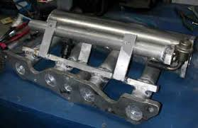 pinto turbo part 1 >this was the intake manifold at the porting stage notice the round fuelrail this would be replaced very soon now this intake manifold could be bolted to