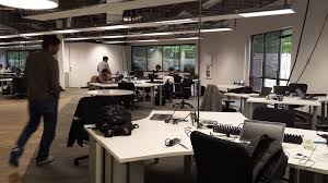 developer office. desks developer walking through a contemporary open office agile development space k