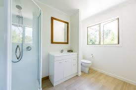 vinyl bathroom flooring. View Past Shower To Sink And Toilet In Sunny Bathroom Vinyl Flooring