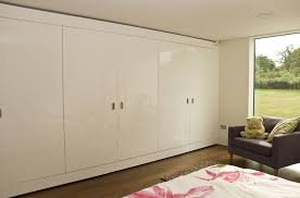 shining fitted bedroom furniture using built in wardrobe big glass window with garden view