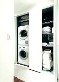 stackable washer dryer cabinet closet dimensions laundry with stacked and design