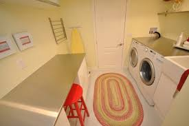 vancouver capel rugs for with modern trash cans laundry room and stainless steel countertop washer