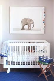 elephant print rug white and blue nursery with baby elephant print over sparrow crib elephant print elephant print rug