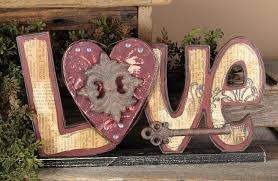 love wooden sign on base