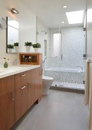 a walk in shower with a tub built into the enclosure