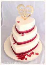 Ivory Burgundy Heart Shape Wedding Cake With Scattered Flowers
