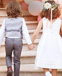 girls dress for wedding. a little girl and boy holding hands girls dress for wedding