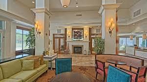 the lounge or bar area at hilton garden inn by hilton mount laurel