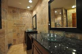 black framed bathroom wall mirrors with double bathroom vanities and cream marble tile under recessed