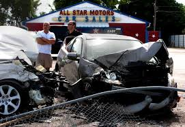 friend ted zahra left and owner of all star motors frank obeid