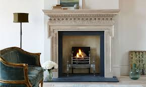 the chichester mantelpiece in limestone with the osterley steel fire basket