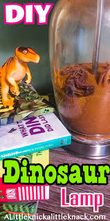 orange dinosaur on top of books next to a dinosaur lamp with a text overlay