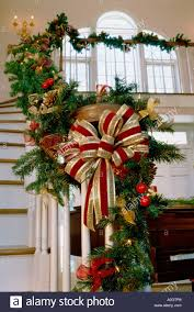 Christmas decorations on a staircase banister
