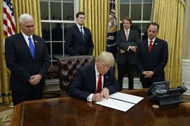 the oval office white house. President Donald Trump, Flanked By Vice Mike Pence And Chief Of Staff Reince Priebus, Signs His First Executive Order On Health Care. The Oval Office White House E